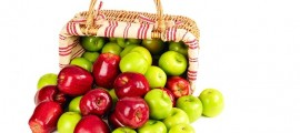 green and red apples in a basket